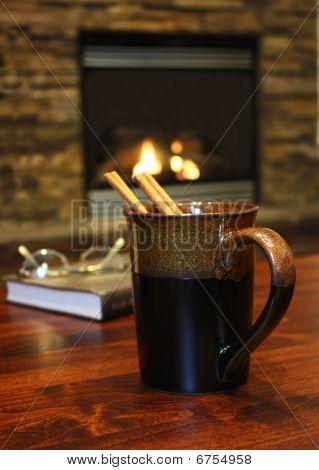 Hot cinnamon tea, warm relaxing environment