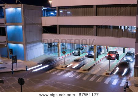 VALENCIA, SPAIN - JUNE 25, 2014: Cars exiting the parking garage at the Valencia airport. Situated 8 km from the city it is the 8th busiest Spanish airport with flight connections to 15 countries.