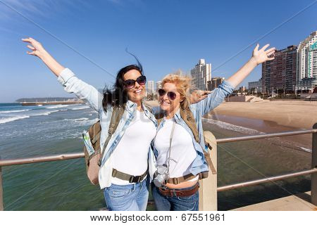 two cheerful tourists by beachfront of Durban, South Africa