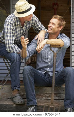 Adult father and son on veranda