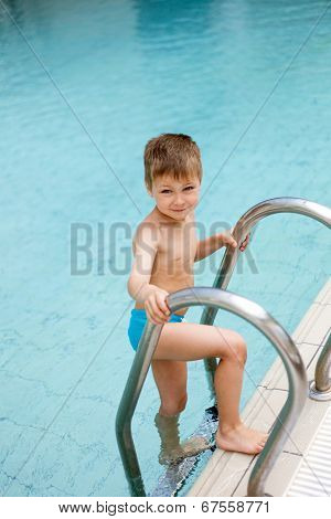 Portrait of little boy in the swimming pool