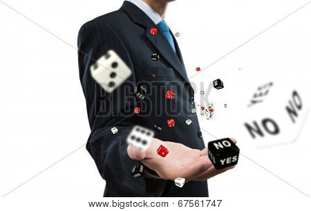 Close up of businessman throwing dice. Gambling concept