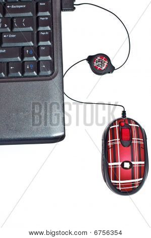 Black Notebook With Red Mouse