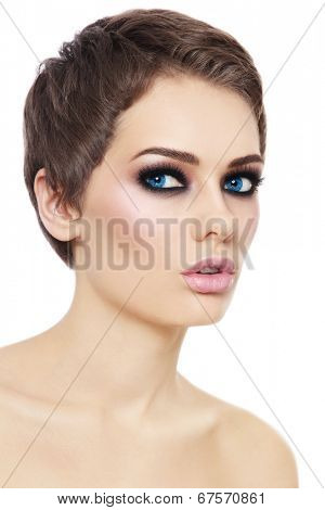 Portrait of young beautiful woman with stylish short haircut and smokey eyes over white background