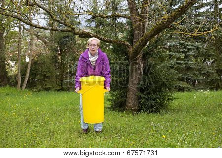 Older Woman With Dustbin