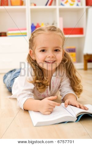 Little Girl Learning To Read