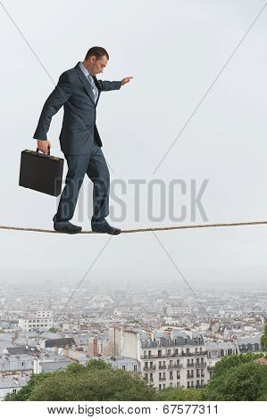 Businessman Walking Across A Tightrope