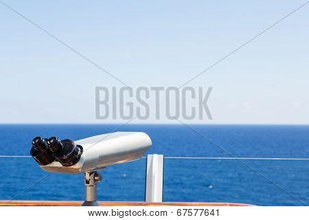Silver Scope Overlooking Blue Sea