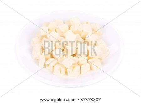 Soft cheese cubes on plate.