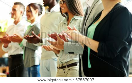 Group of cheerful business team applauding