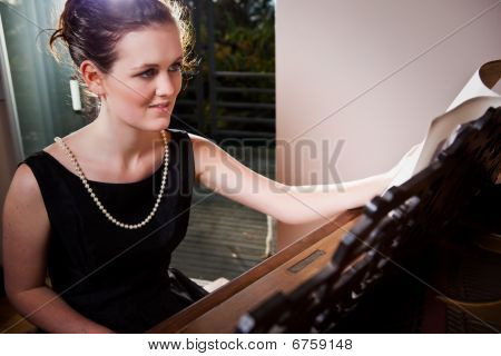 Beautiful Teenager Playing Piano