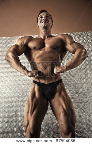 Low angle view of male bodybuilder in a pose