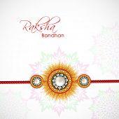 picture of rakhi  - Beautiful rakhi on floral decorated grey background on the occasion of Happy Raksha Bandhan festival - JPG