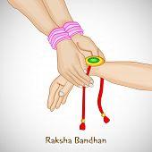 image of rakhi  - Beautiful background for Raksha Bandhan celebrations with girl tying rakhi on brother hand on grey background - JPG