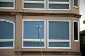 picture of window washing  - Window Washing with Deionized water and extension pole - JPG