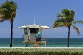 image of lifeguard  - Fort Lauderdale Sunrise Beach with beautiful ocean water palm trees and lifeguard station - JPG