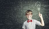pic of formulas  - Genius boy in red glasses near blackboard with formulas - JPG