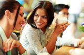 stock photo of debate  - Portrait of young smiling businesswomen having coffee break - JPG