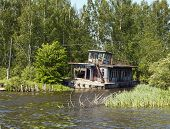image of pontoon boat  - The Old pontoon house on river Volga - JPG