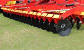 stock photo of cultivator-harrow  - A Large Disc Harrow Trailer for a Farming Tractor - JPG