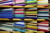 foto of tailoring  - Manz colorful fabrics on sale at a fabric store - JPG