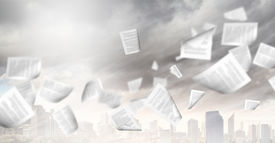 stock photo of blown-up  - background image with papers flying in air - JPG