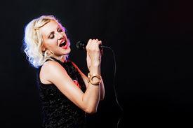 pic of karaoke  - Beautiful singing woman with microphone - JPG