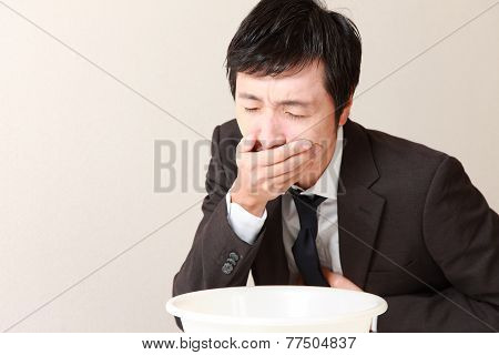 vomiting businessman
