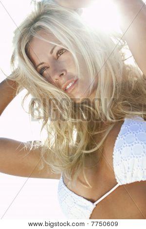 Backlit Sexy Blond Girl In White Bikini