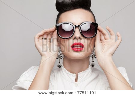 Close Up Portrait Of Beautiful Vintage Styling Model Wearing Round Black Sunglasses. Updo, Large Ear