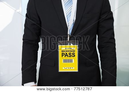 Midsection Of Businessman Wearing Backstage Pass