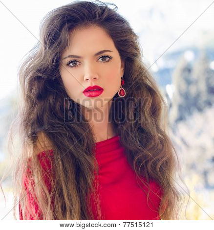 Beautiful Young Girl With Red Lips, Long Wavy Hair Wearing In Red, Outdoors Portrait.