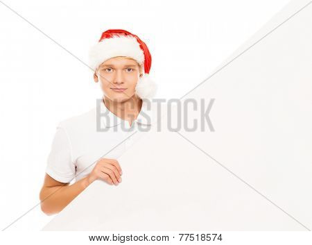 Handsome young man with a blank billboard isolated on white background