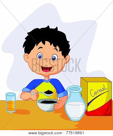 little boy having breakfast cereals with milk
