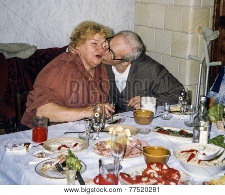 Vintage photo of elderly couple's wedding anniversary, eighties