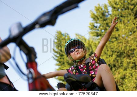 Little girl in a bicycle seat