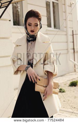 Beautiful Ladylike Woman In Elegant Beige Coat And Silk Scarf