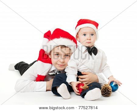 Boys Brothers In Santa's Hats Hugging