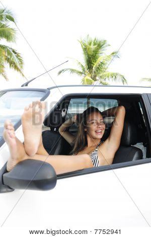 Car Rental: Woman Relaxing In Her Car Near The Beach