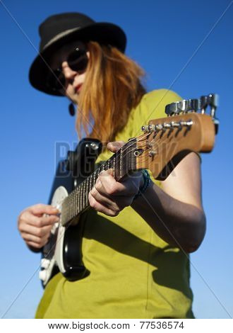 Stylish female musician, vertical