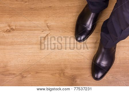 Legs Of Businessman On Parquet, Top View