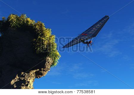 Rock and hang-gliding against the sky.