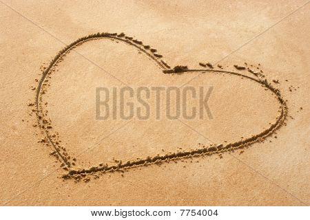 Heart Shape Symbol On Sandy Beach