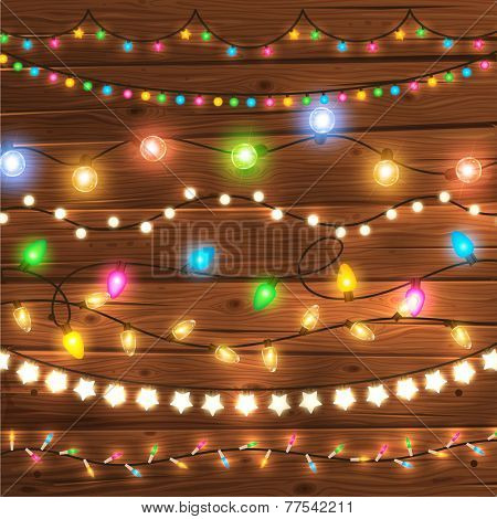 Set of Glowing Christmas Lights for Xmas Holiday Greeting Cards Design. Wooden Hand Drawn Background. Light Bulbs Collection.