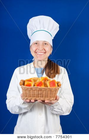 Female Cook With Cookie Over Blue