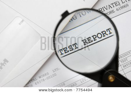 Closeup Of Magnifying Glass On Test Report
