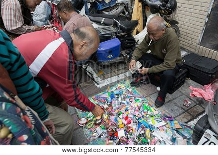 TAIPEI, TAIWAN - November 16th : Street vendor sell various of daily necessities near Longshan Temple, Taipei, Taiwan on November 16th, 2014.