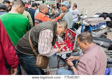 TAIPEI, TAIWAN - November 16th : Street vendor selling various watches near Longshan Temple, Taipei, Taiwan on November 16th, 2014.