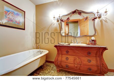 Bathroom With Claw Foot Tub And Antique Vanity