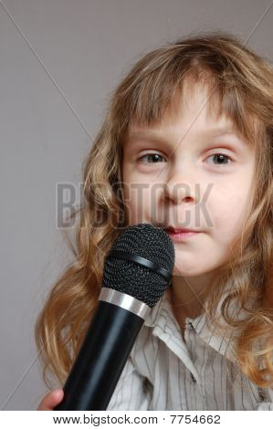 Cute Little Girl With Black Microphone.